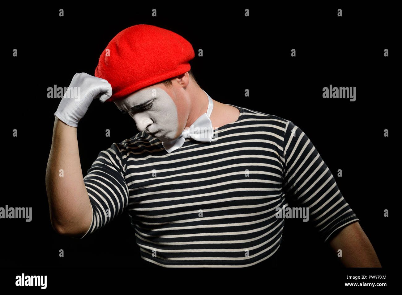 Thoughtful mime, isolated on black - Stock Image