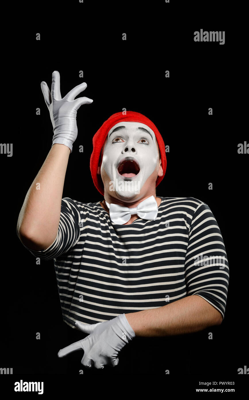 Male mime on black - Stock Image
