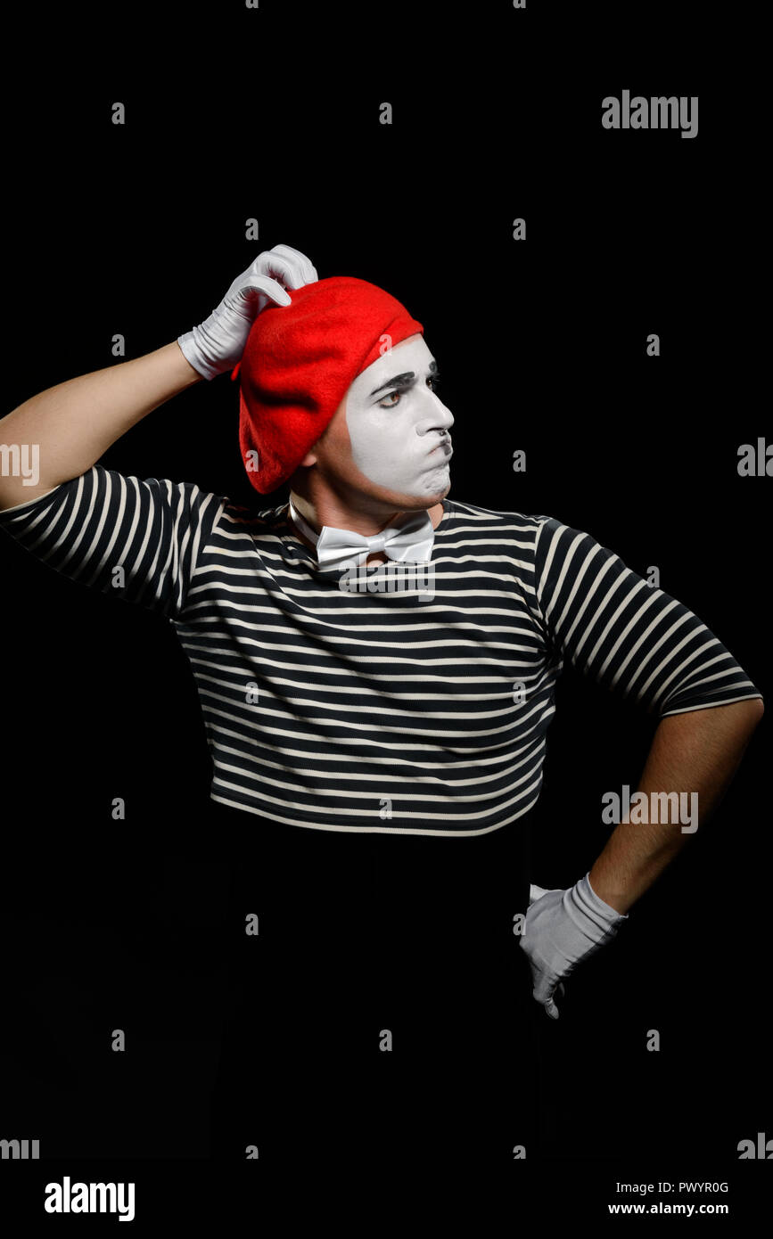 Mime thinking and touching head - Stock Image