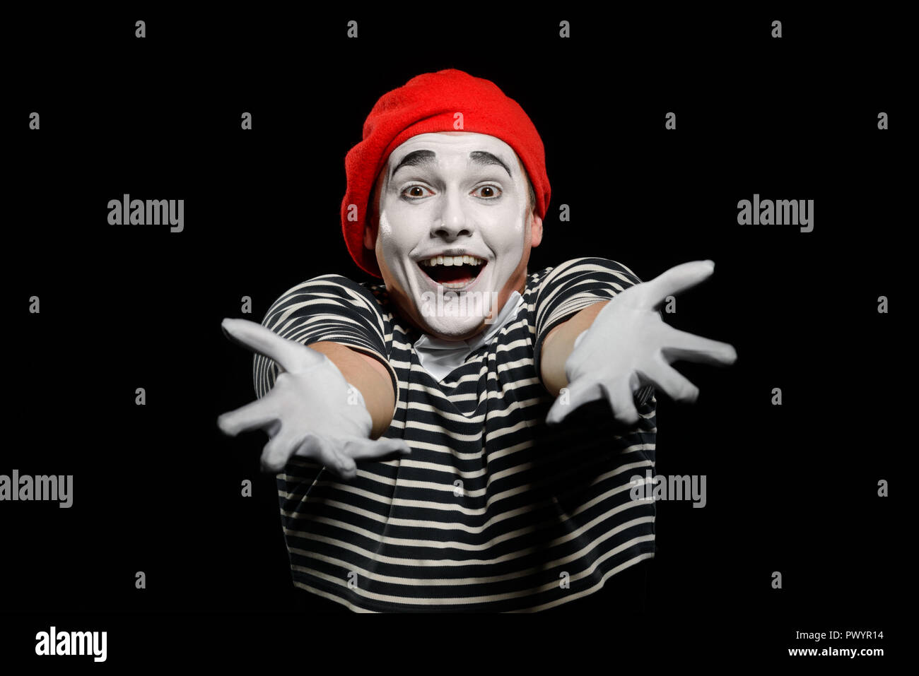 Mime stretched out his hands - Stock Image