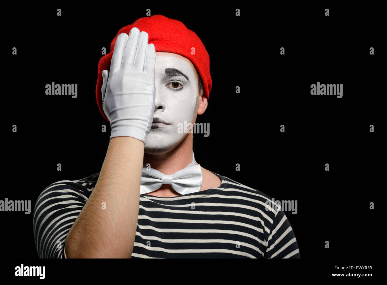 Mime covering half of face - Stock Image