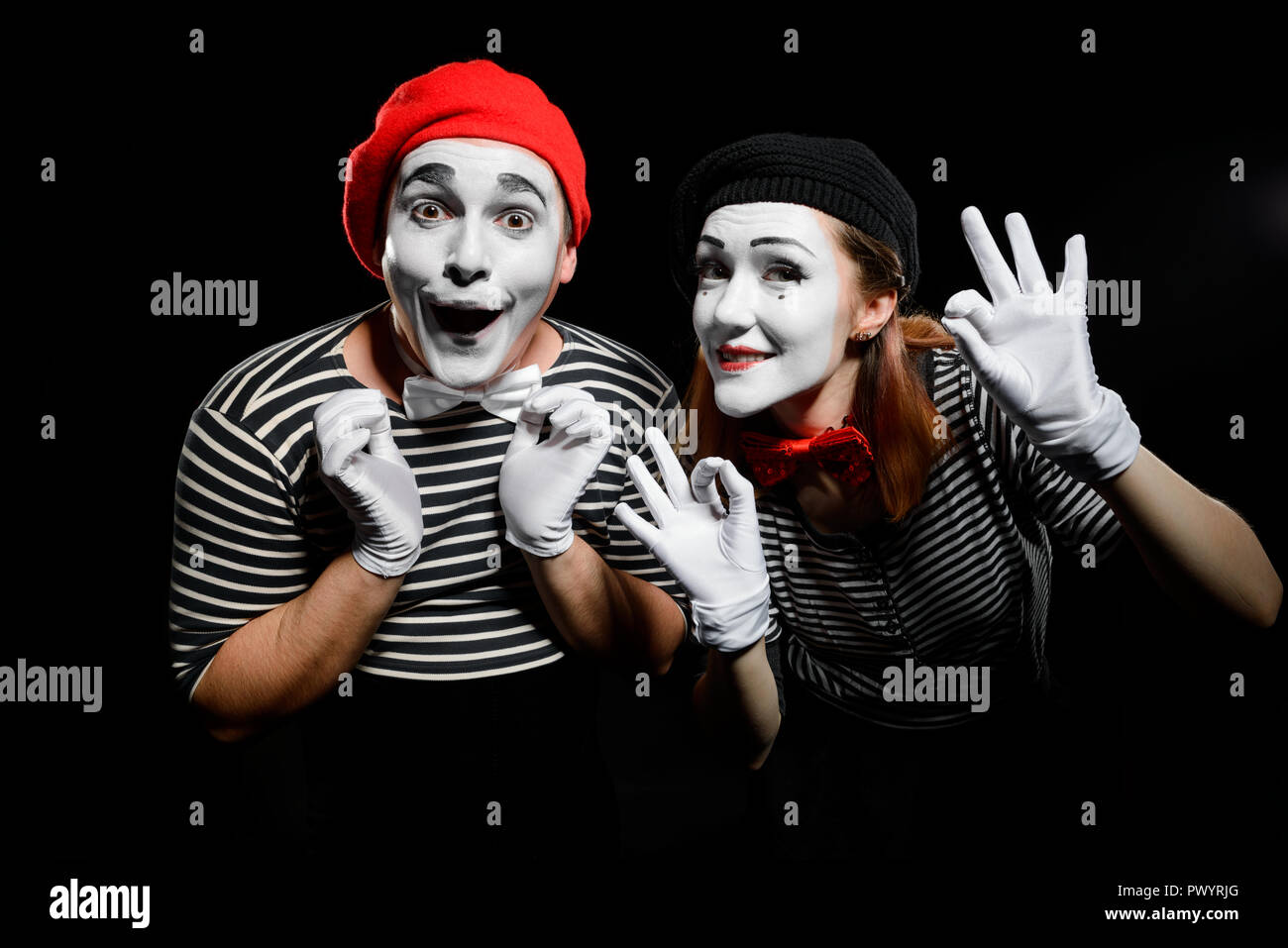 Cute mime artists on black - Stock Image