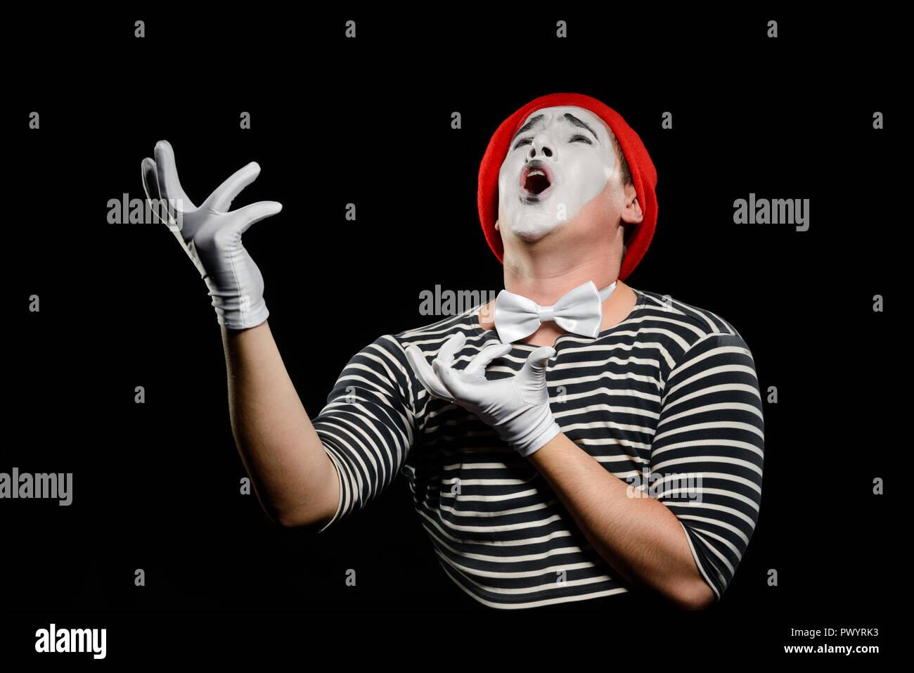 Male mime singing opera - Stock Image