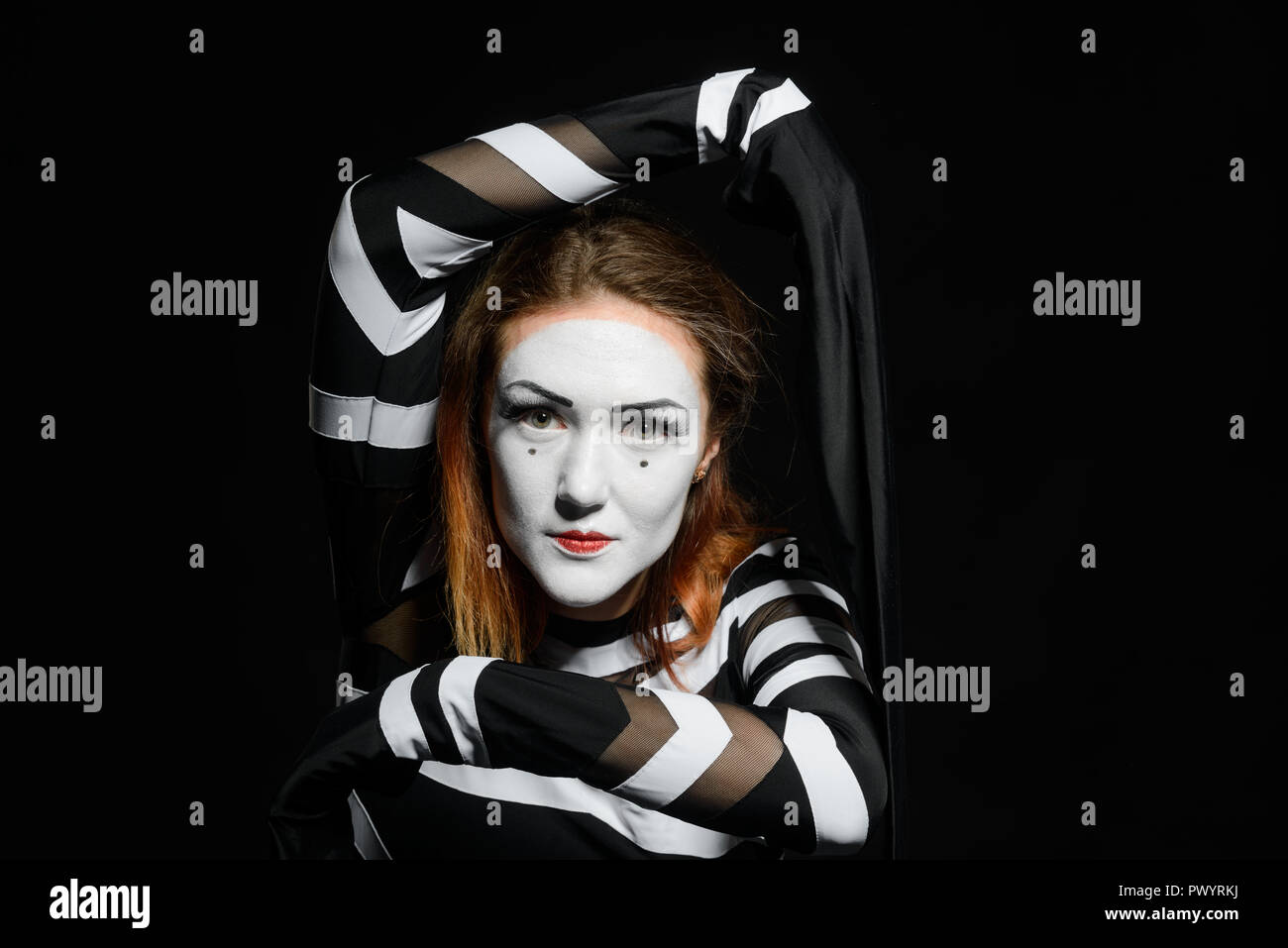 Portrait of female mime artist - Stock Image