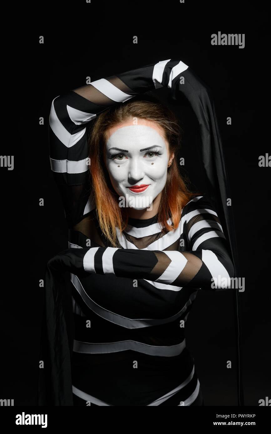 Female mime artist on black - Stock Image