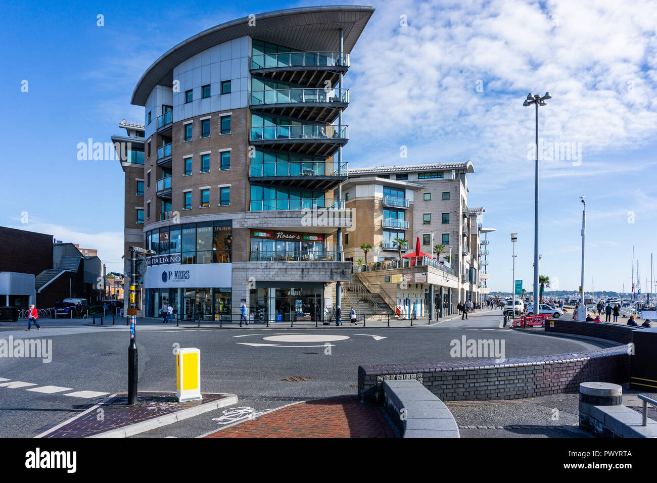 Modern block of luxury flats on the sea front at Poole Harbour in Dorset, UK on 18 October 2018 - Stock Image