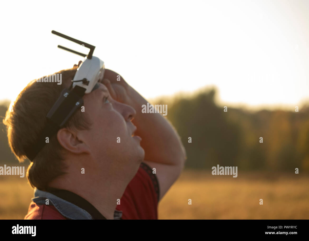Drone pilot wearing first-person view headset. Young man driving a quad-copter using video-goggles Stock Photo