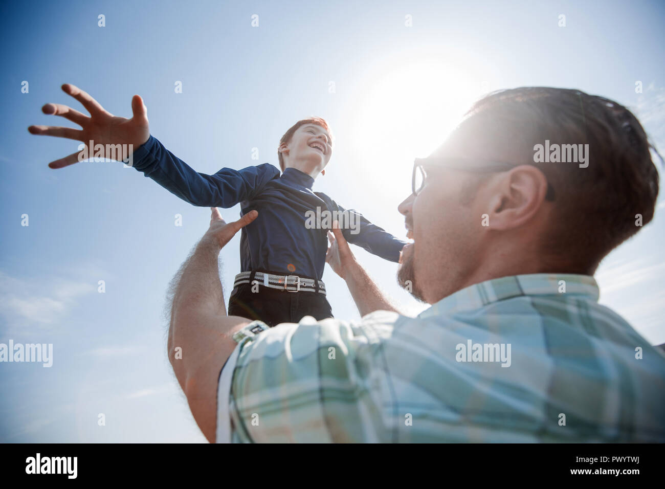 happy father and son playing together.the concept of fatherhood - Stock Image