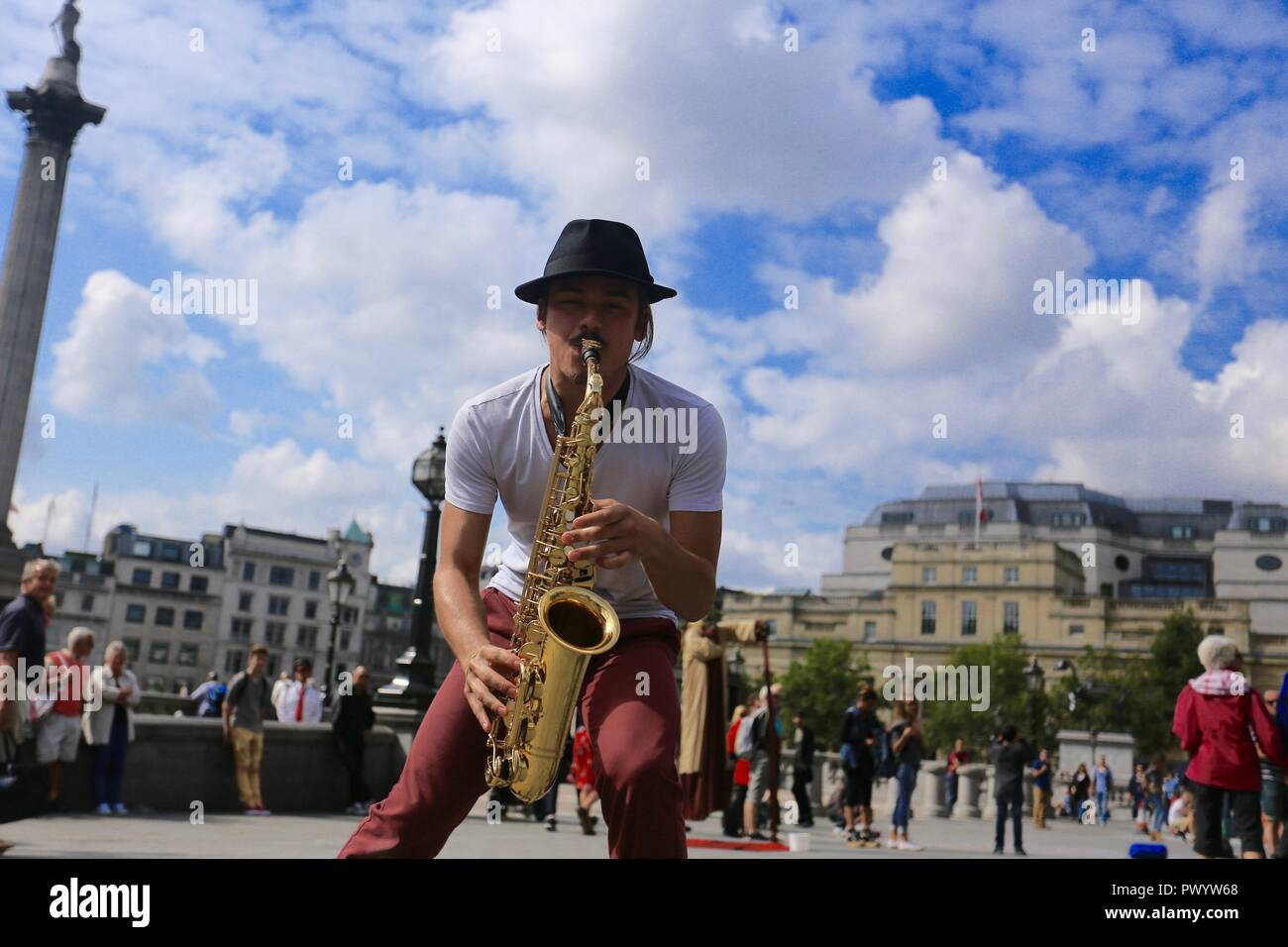 Jazz Busker playing Saxophone in front of the National Gallery, Trafalgar Square, London. - Stock Image