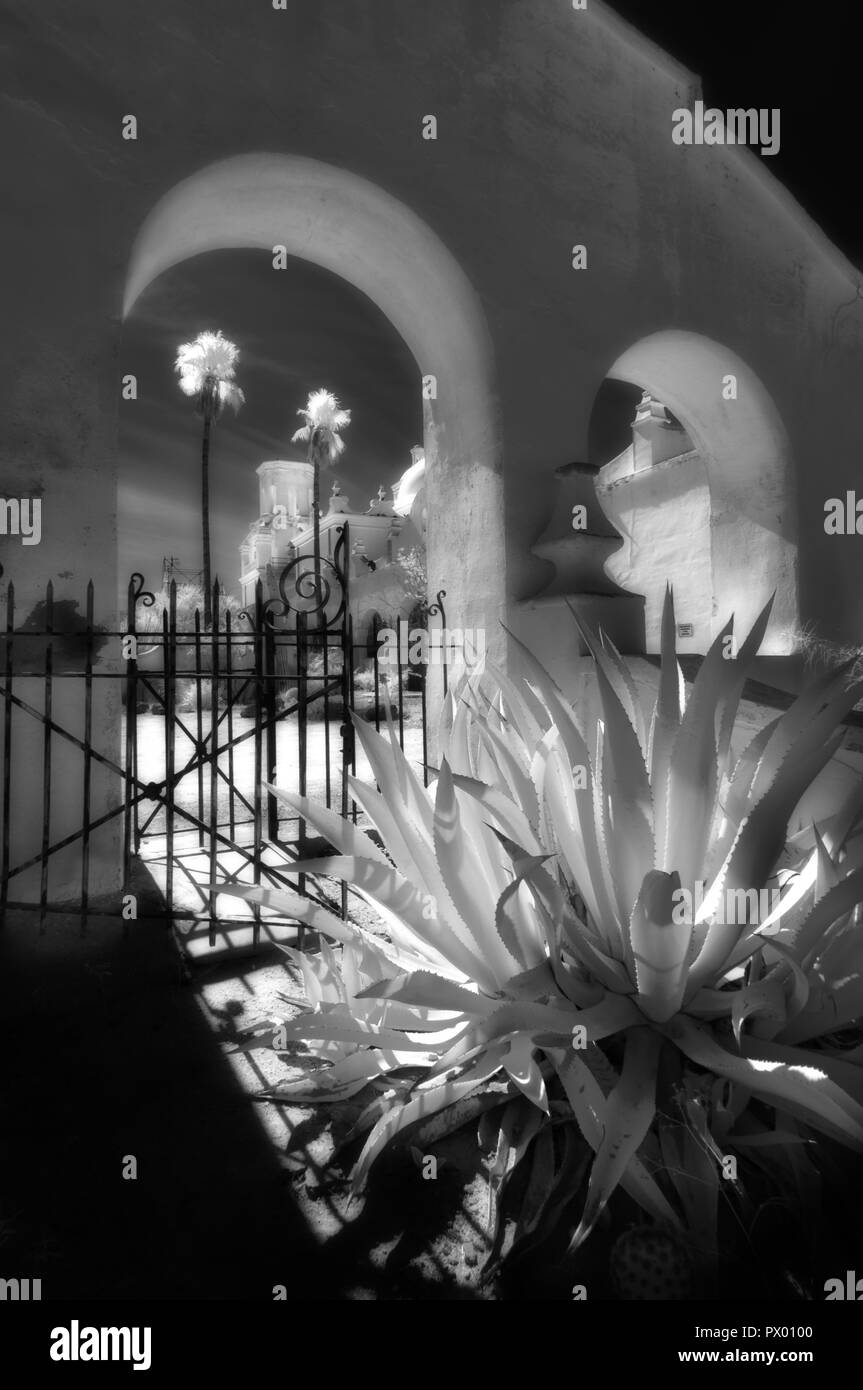 An infrared fine art style image of San Xavier  Del Bac Mission near Tucson Arizona - Stock Image