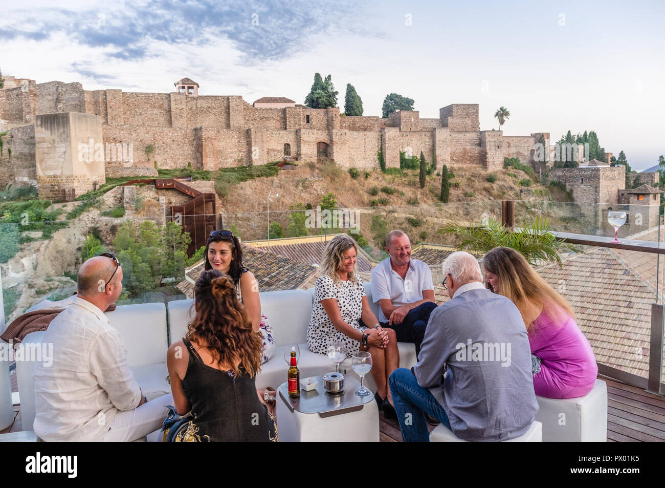 People With Alcazaba Castle In Background At The Rooftop