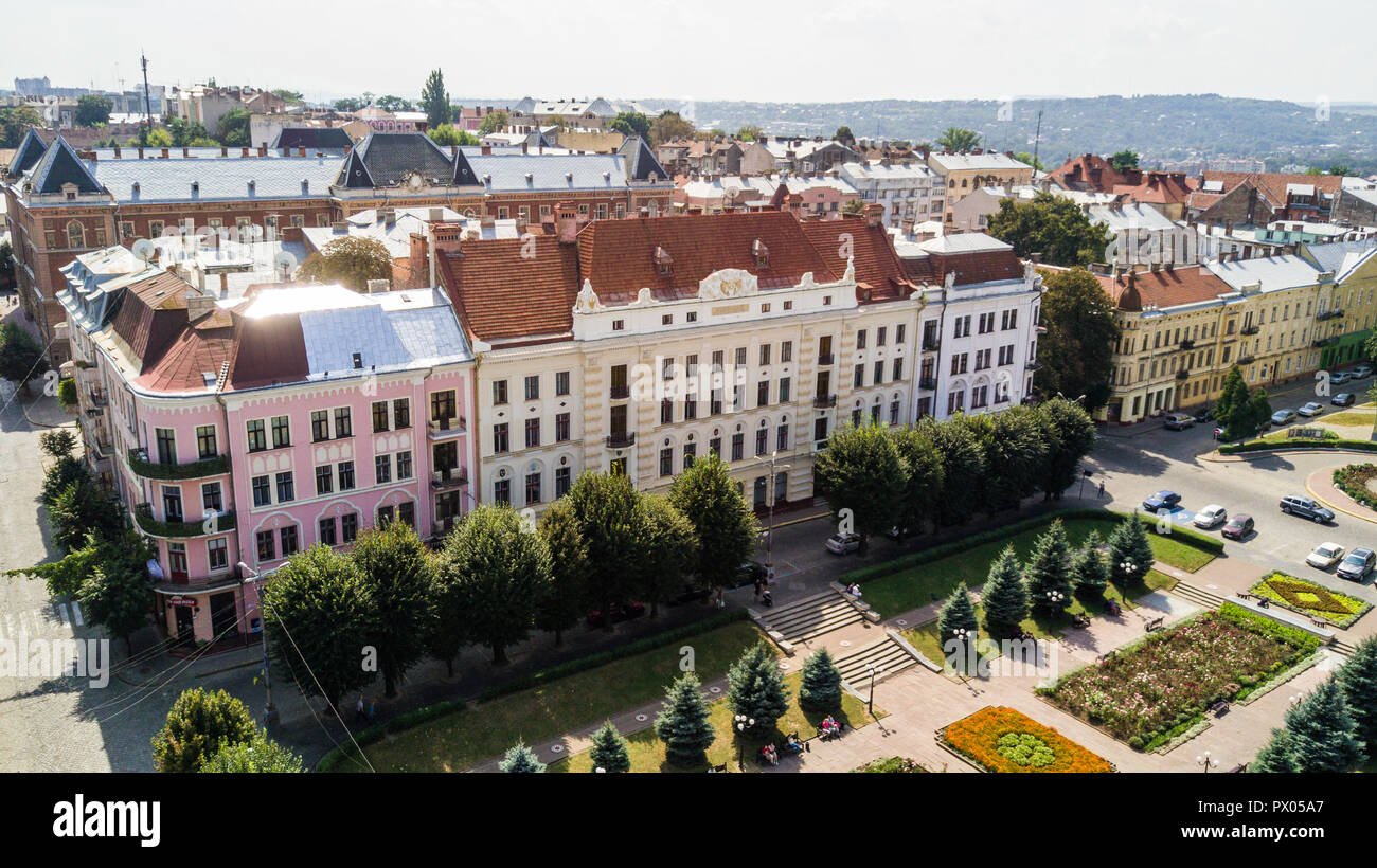 Chernivtsi city from above Western Ukraine. Bukovinian medical University building and Theatre square of Chernivtsi on sunset view. - Stock Image