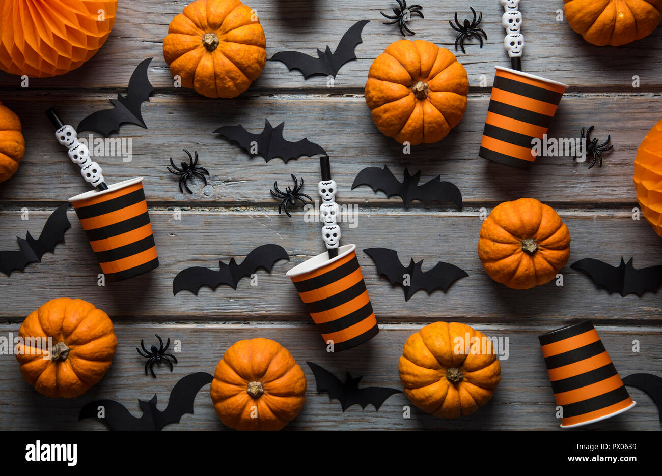 Halloween Party Decorations On A Rustic Wooden Background