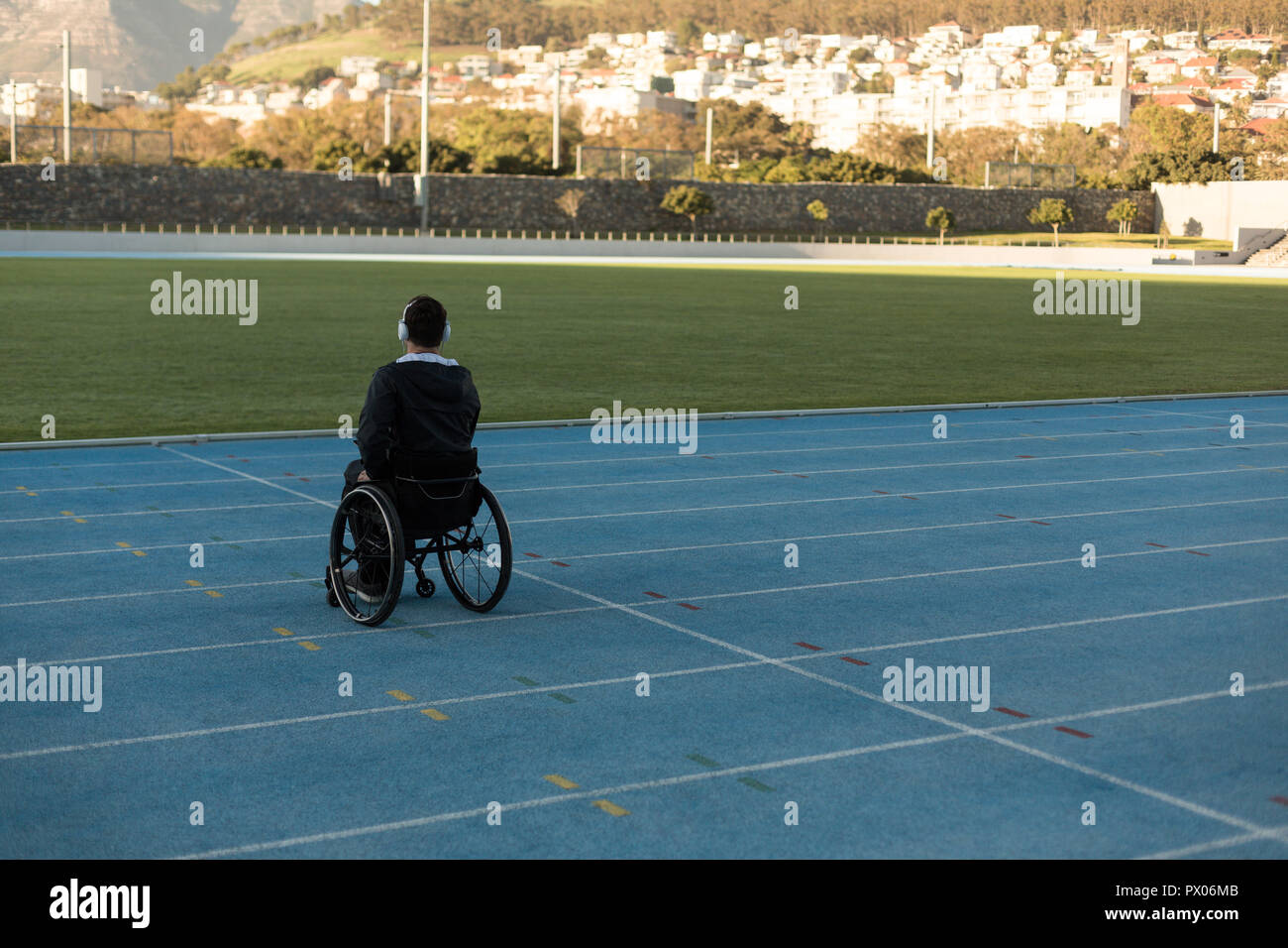 Disabled athletic listening music on headphones - Stock Image