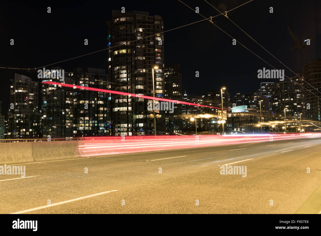 Downtown with light trail - Stock Image