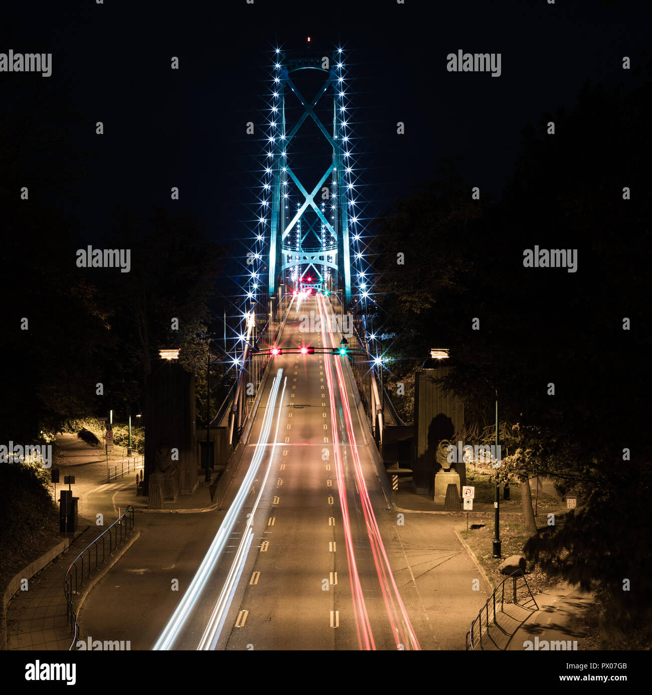 Suspension bridge with light trail - Stock Image