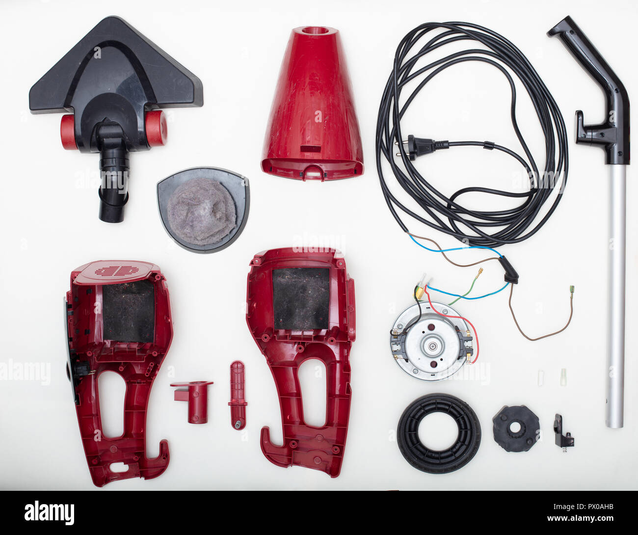 Vacuum cleaner, vacuum cleaner parts, disassembled vacuum cleaner with dirty filter - Stock Image
