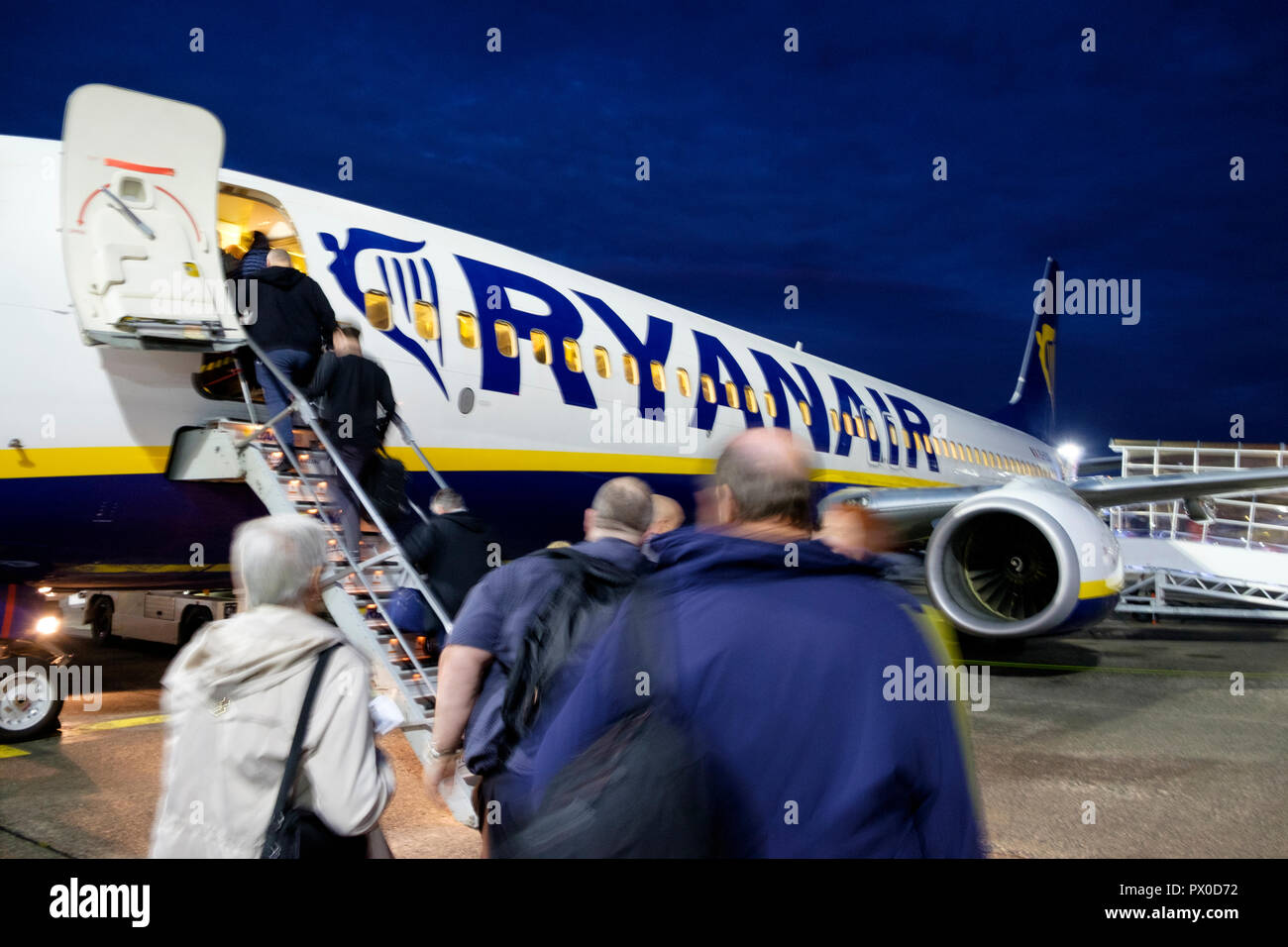 Passengers board a Ryanair aircraft for a flight from Glasgow Prestwick airport. Stock Photo