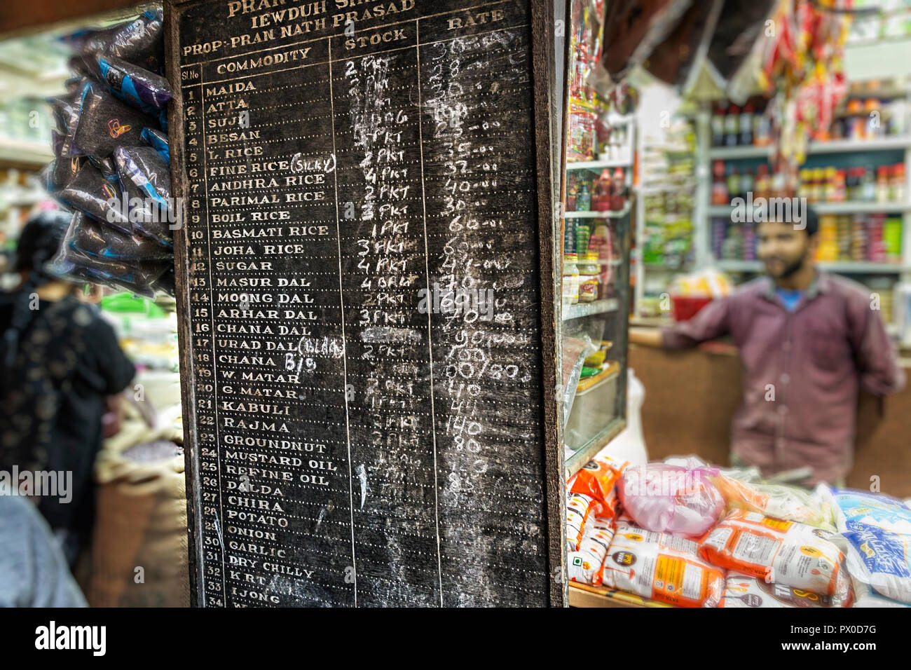 Prices of rice and food in shop in market, Shillong, Meghalaya, India - Stock Image