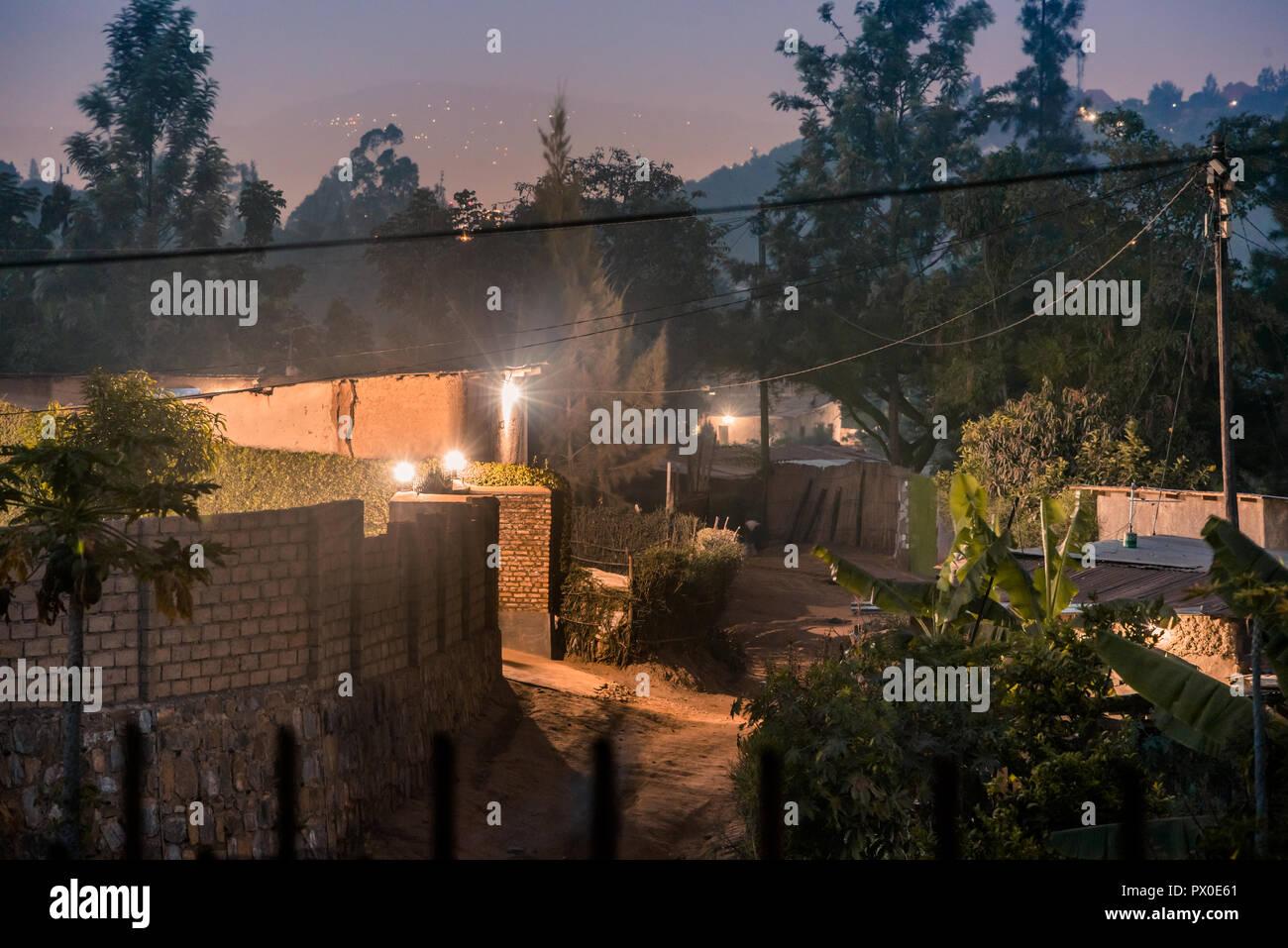 Dimly lit street scene among houses in Nyamirambo, an outlying suburb of Kigali - Stock Image