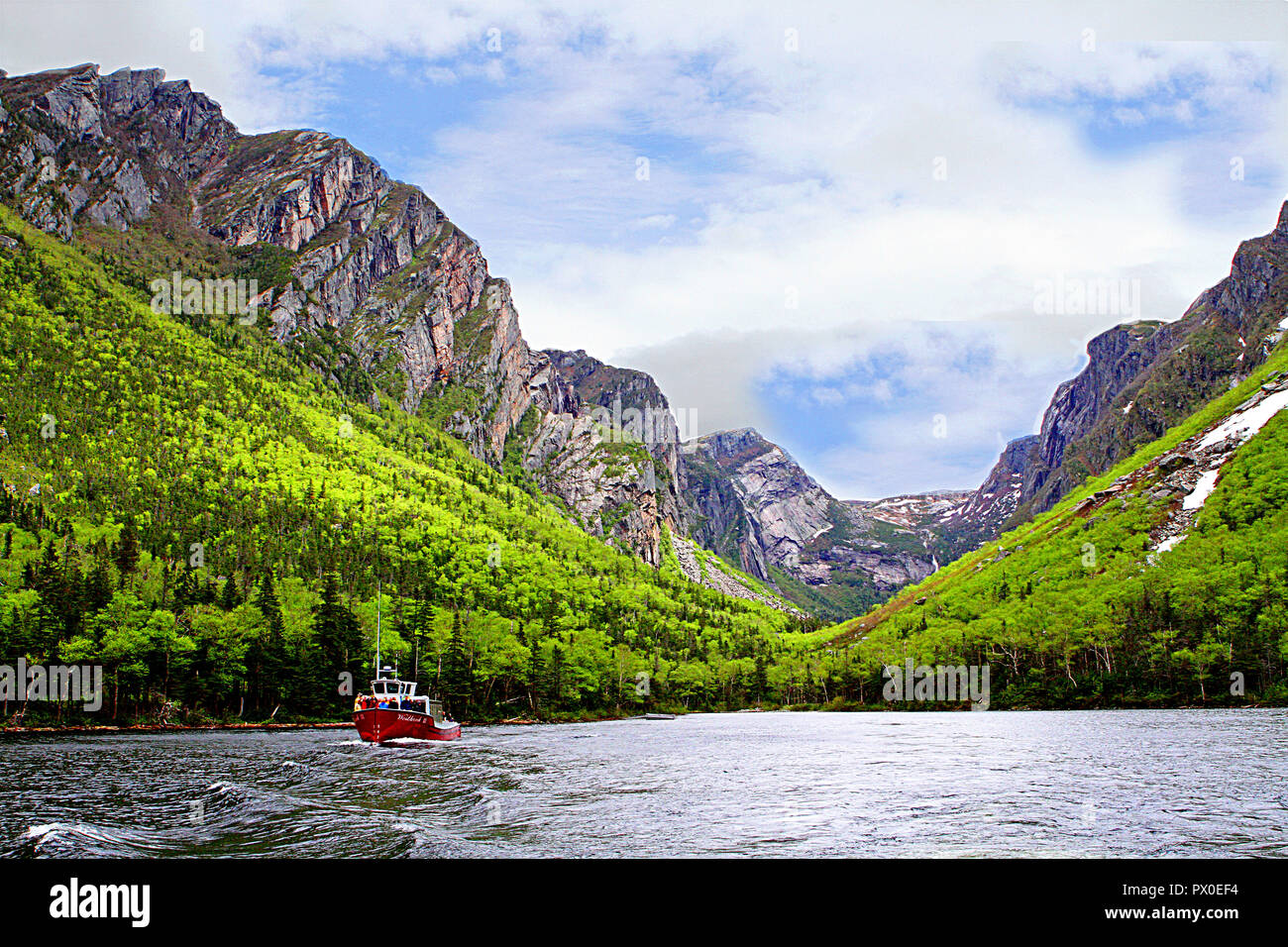 Tour boat in Western Brook Pond, Gros Morne National Park, Newfoundland, Canada, Tabletop Mountains, inland fjiord - Stock Image