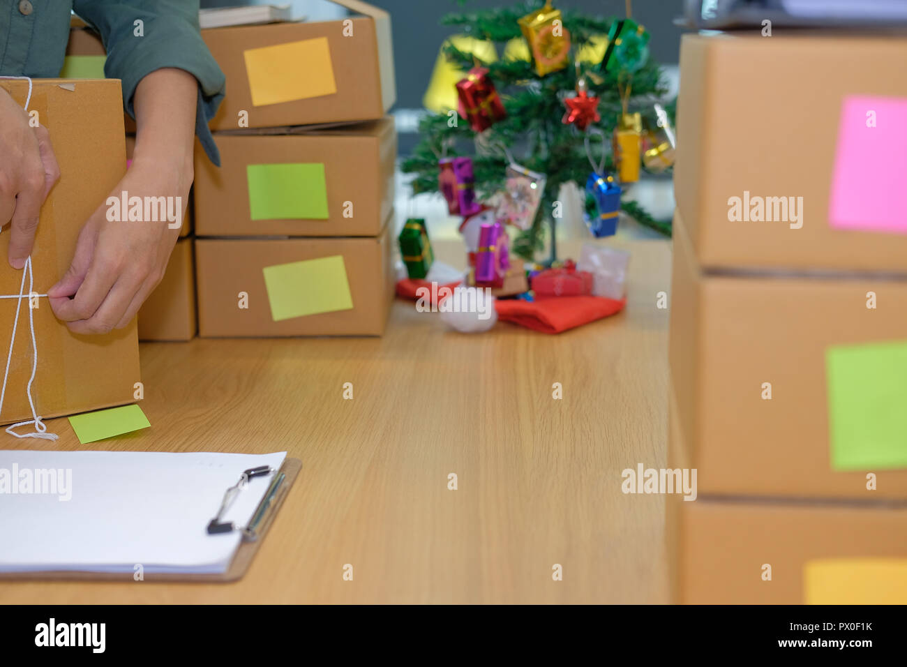 startup small business owner packing cardboard box at workplace