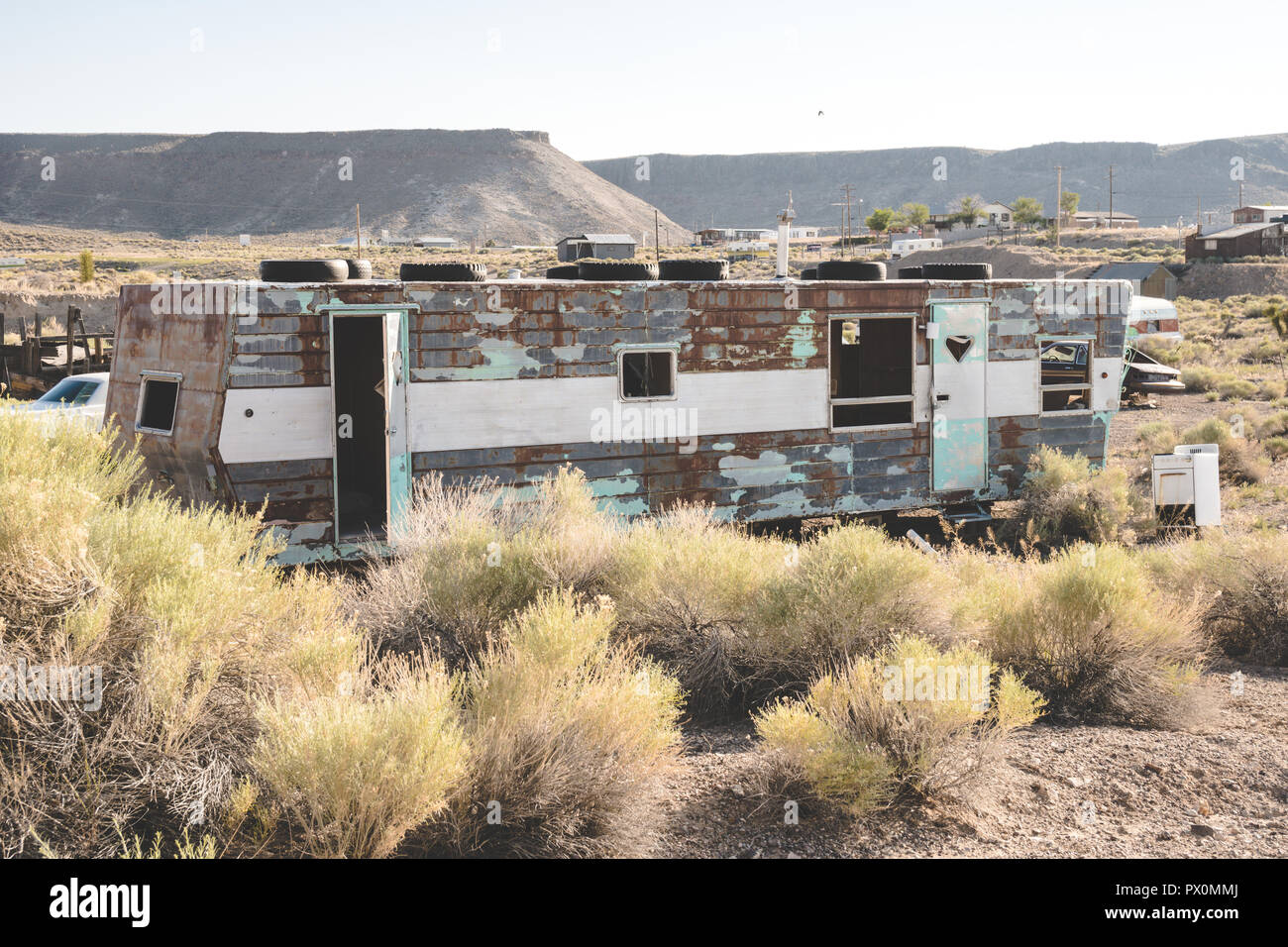 Abandoned trailers, appliances, tires and vehicles in the desert in Goldfield Nevada - Stock Image
