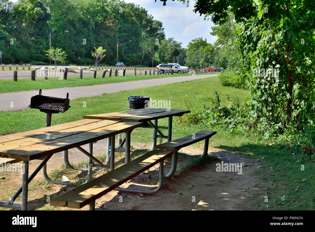 Durand Eastman Beach park picnic table, BBQ on Lake Ontario, one of the Great Lakes, near Rochester, New York, USA - Stock Image