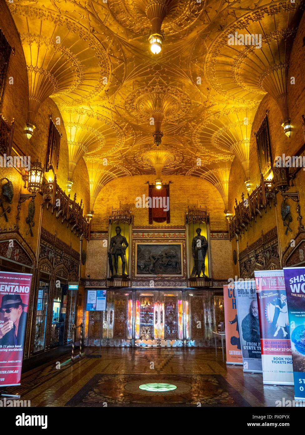 Fan vaulted ceiling and Gothic style foyer of the State Theatre featuring bronze statues Market Street Sydney NSW Australia. - Stock Image