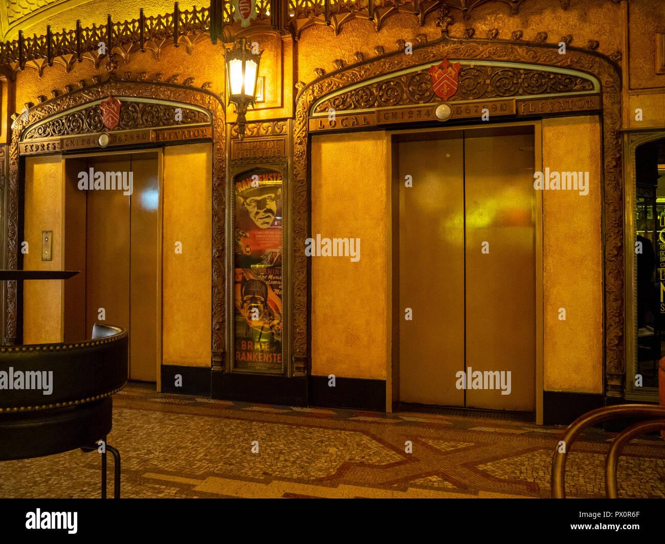 Art Deco ornate elevators in the lobby of the QT Hotel Market Street Sydney NSW Australia. - Stock Image