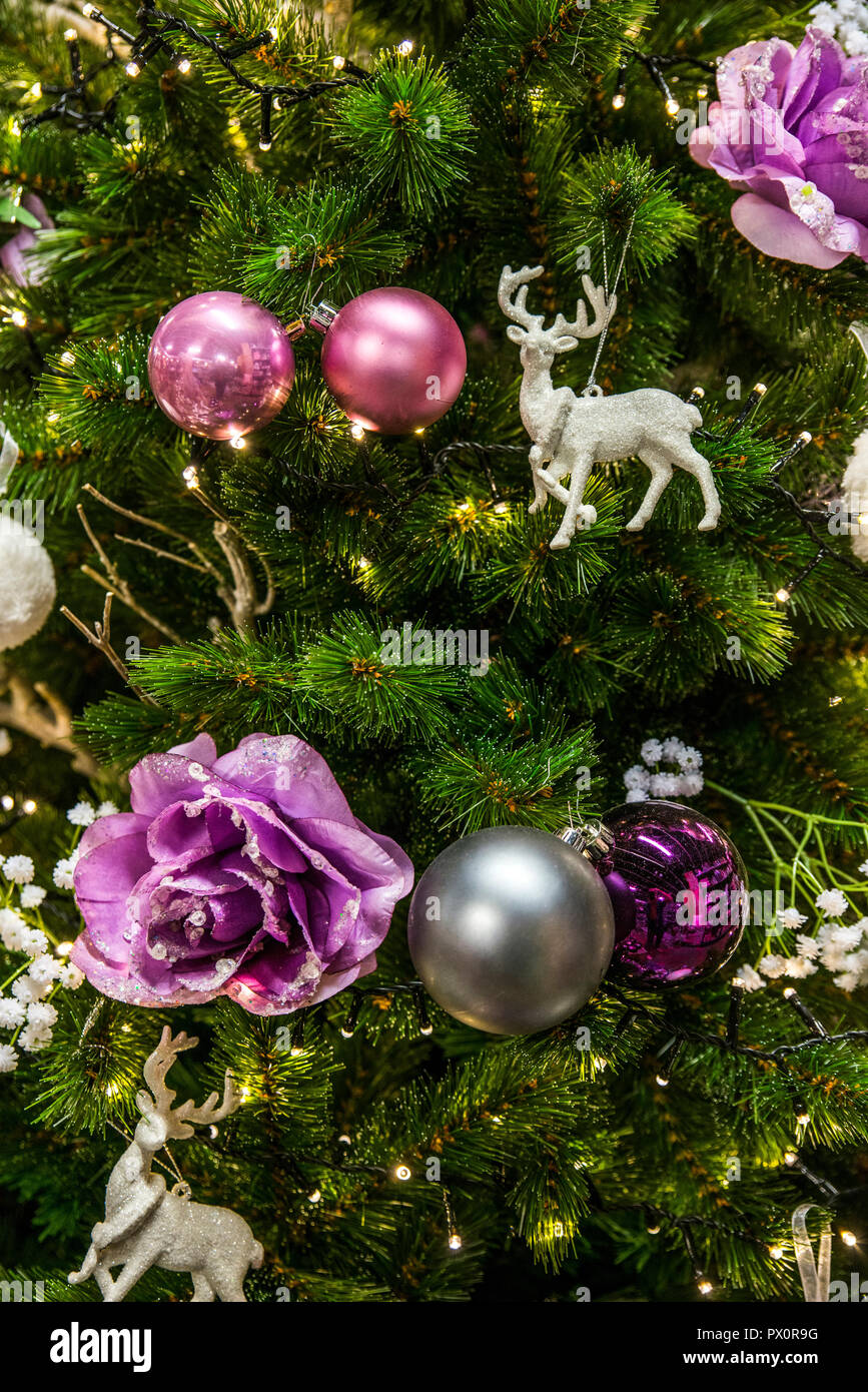 Purple And Silver Christmas Trees.Background Of Christmas Tree With Decorations In Purple And