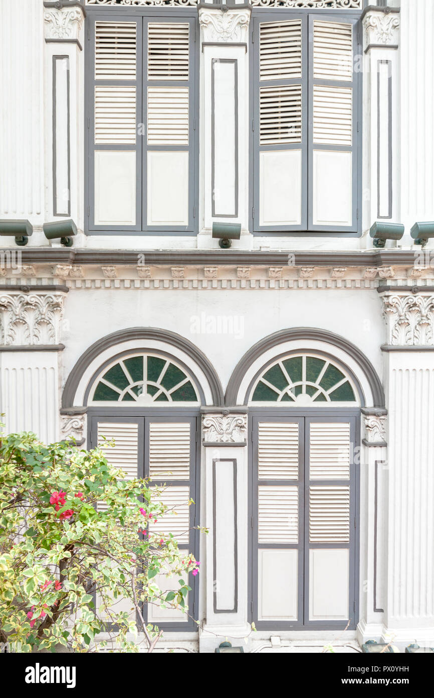 Shophouse, historic building traditional architecture, shutters and slatted windows, the nonya style, within China Square Central, Singapore - Stock Image