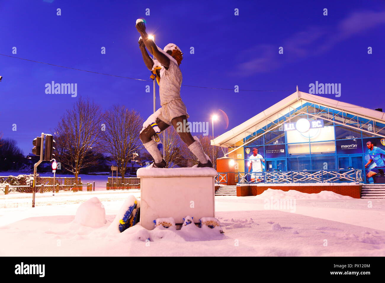 The Billy Bremner memorial outside the East Stand of Elland Road Football Stadium covered in snow. - Stock Image