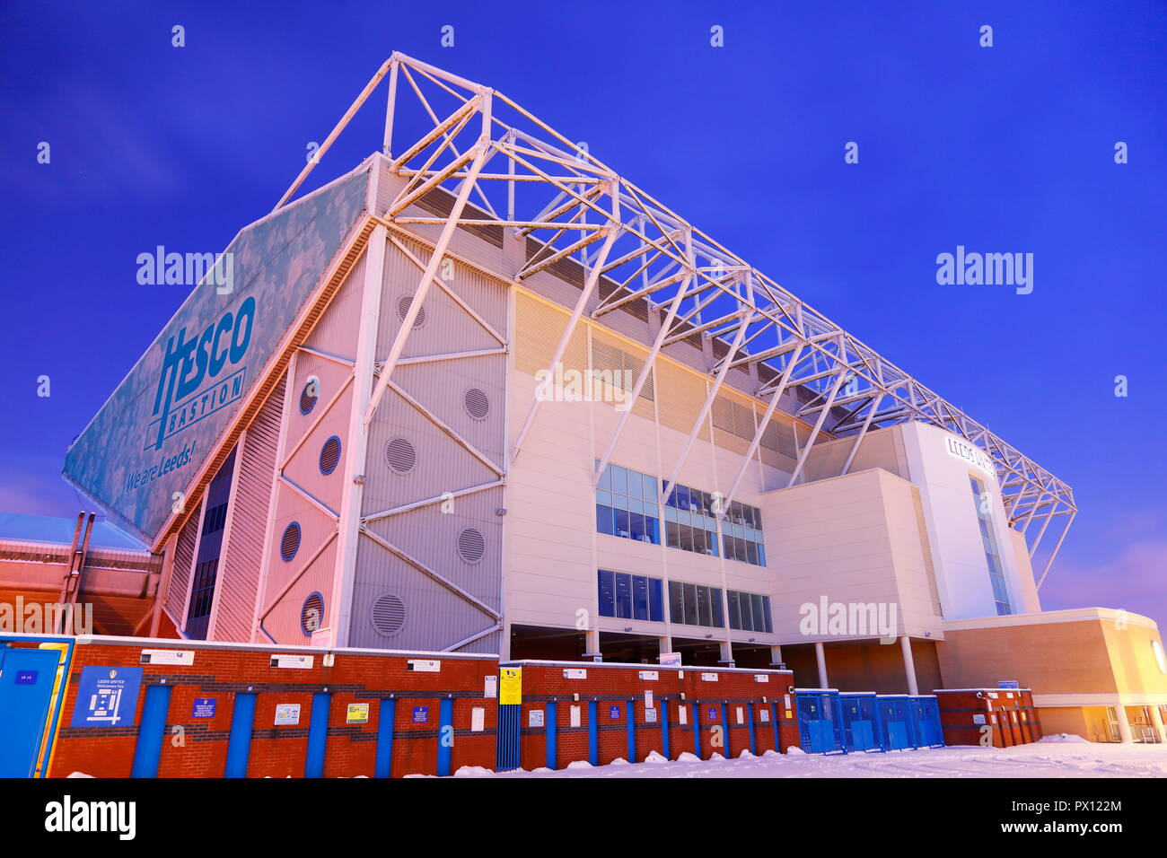 East Stand of Elland Road Football Stadium on a snowy morning. - Stock Image