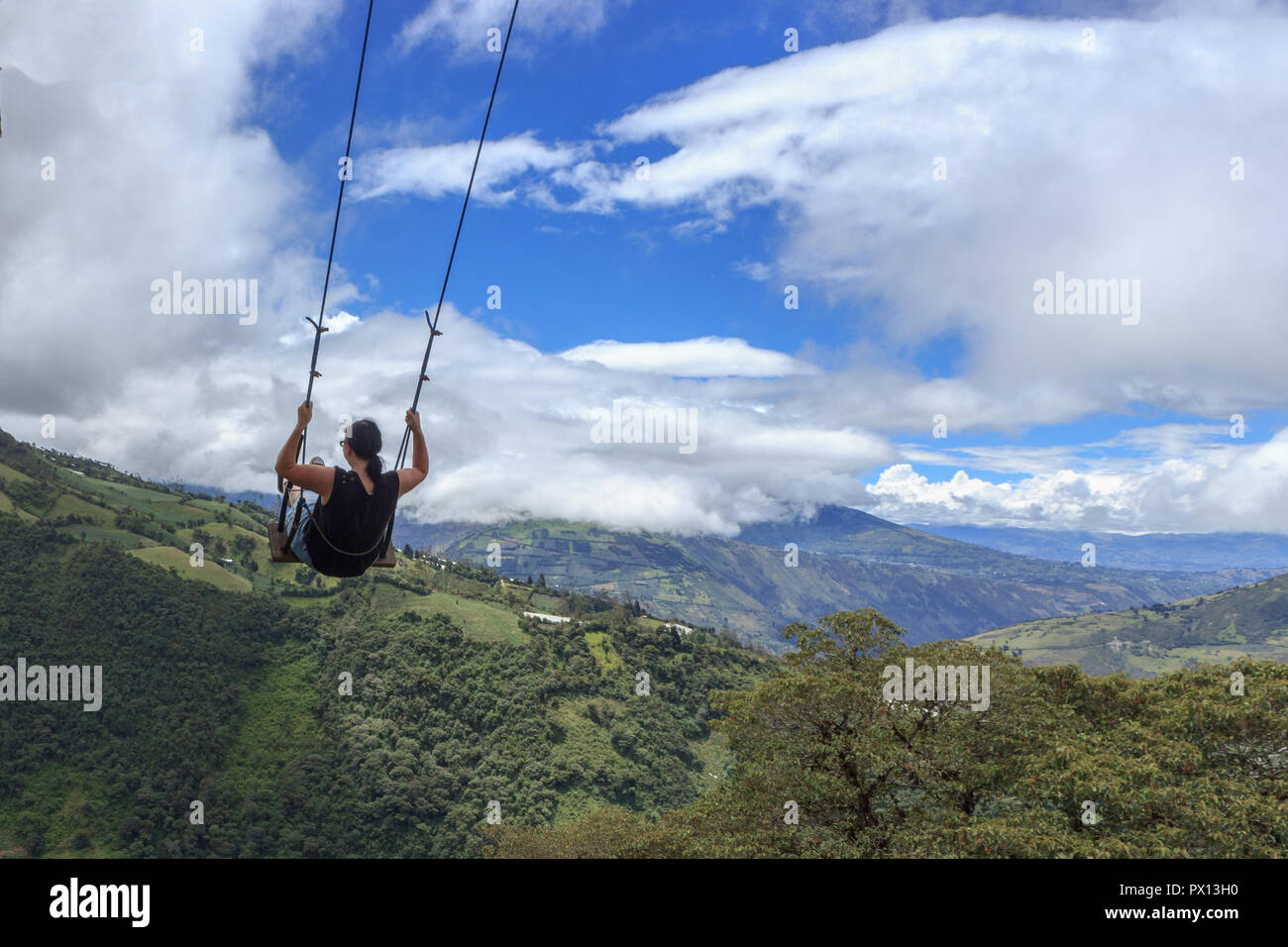 Swinging over the end of the world, ecuador - Stock Image