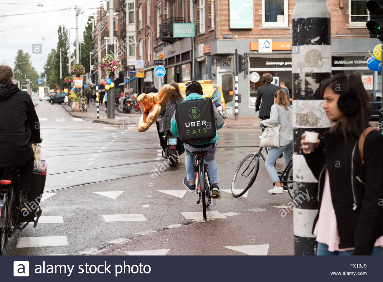 Uber Eats backpack food delivery cyclist in Amsterdam at the