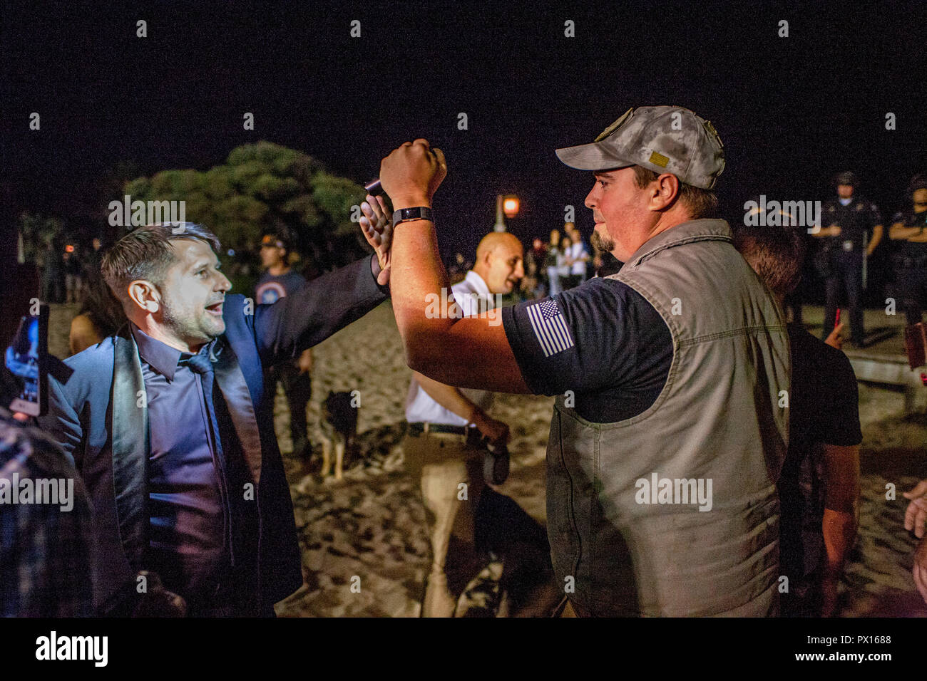 Right-wing and left-wing demonstrators confront each other at a political rally at Laguna Beach, CA's Main Beach. - Stock Image