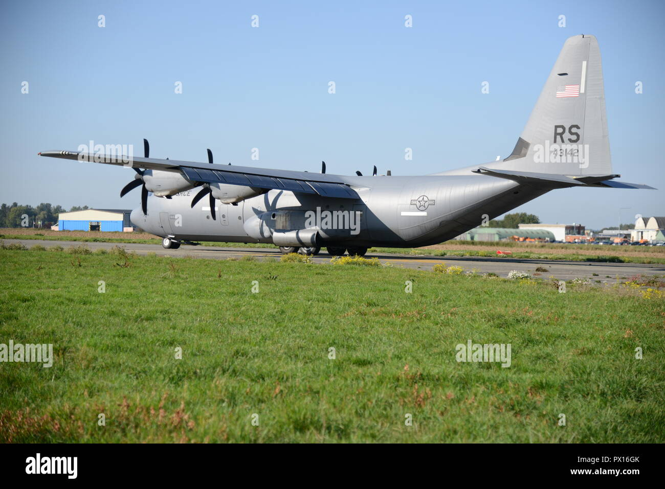 A C-130J Super Hercules of the 86th Airlift Wing lands on SHAPE Air Field on Chièvres Air Base, Belgium, Oct. 4, 2018. The exercise's objective was to validate the use of the drop zone and see increased training capabilities for NATO. (U.S. Army photo by Visual Information Specialist Henri Cambier) - Stock Image