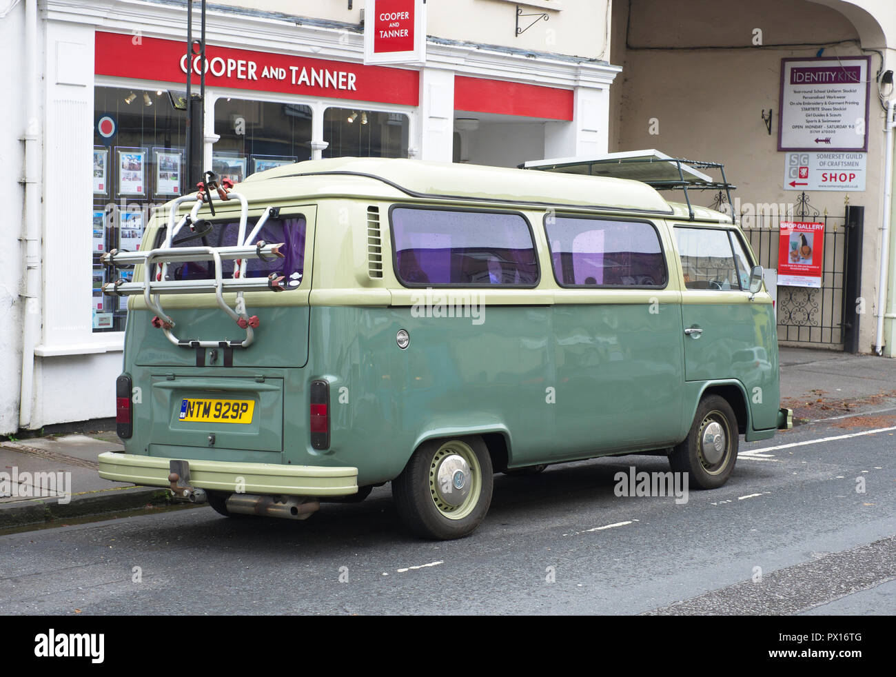 A fully restored classic 1976 Volkswagen delivery/camper van parked on Broad St., Wells, Somerset, UK - Stock Image