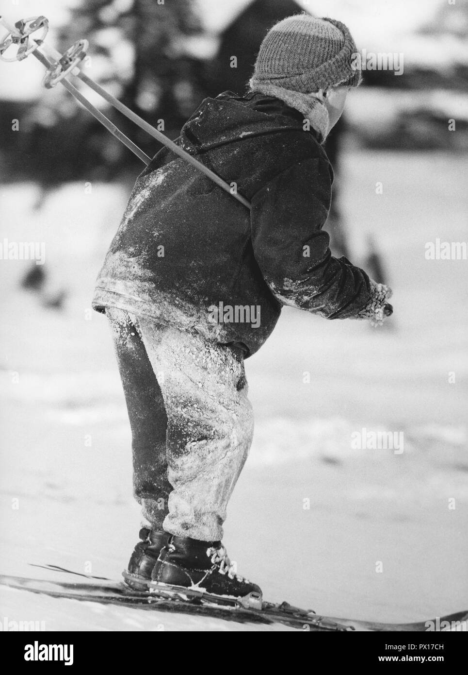 Winter in the 1960s. A boy is skiing. By the looks of the snow on his clothes, he has fallen many times. Sweden 1960s Stock Photo