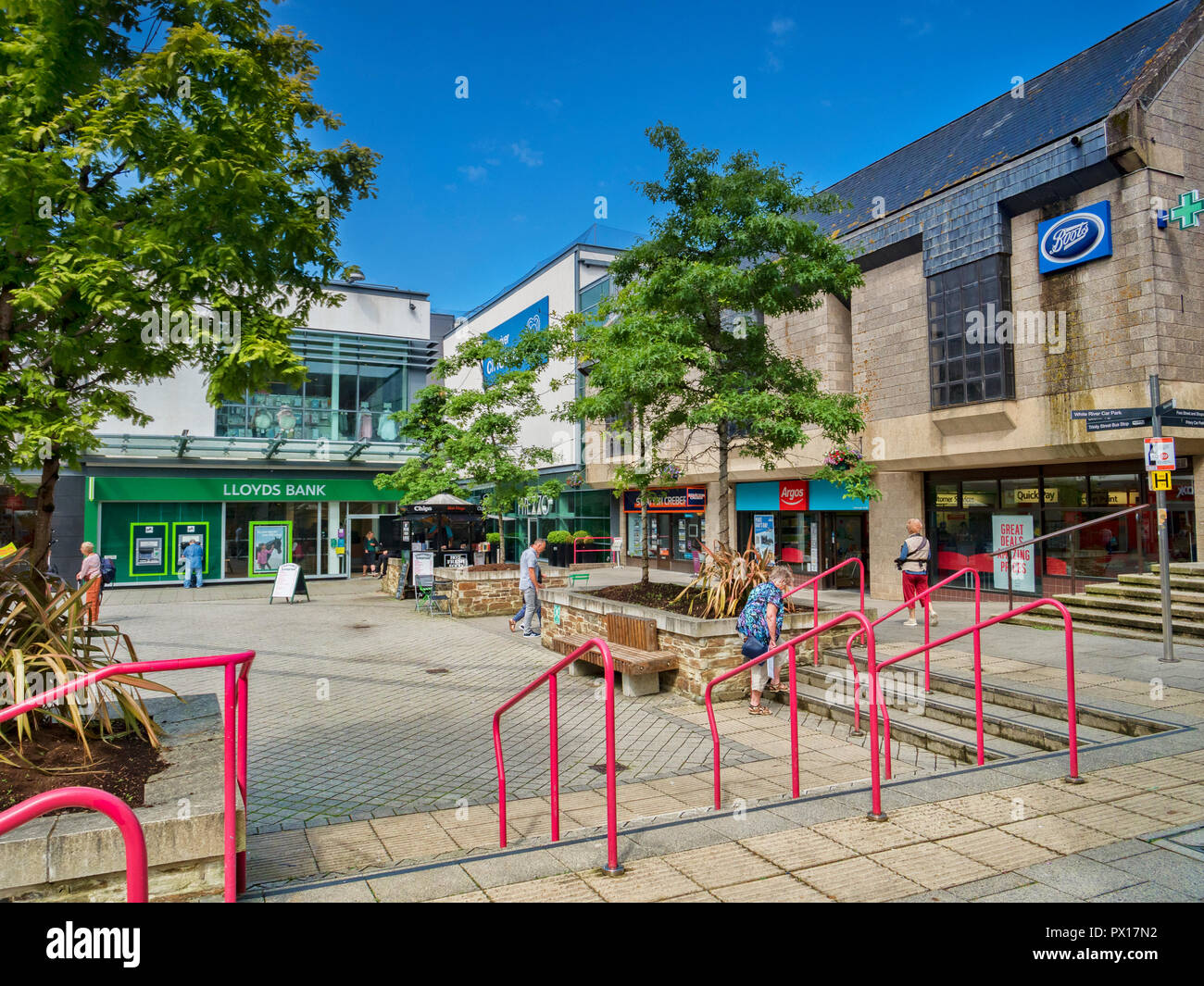 11 June 2018: St Austell, Cornwall, UK - Shops and shoppers in White River Place. - Stock Image