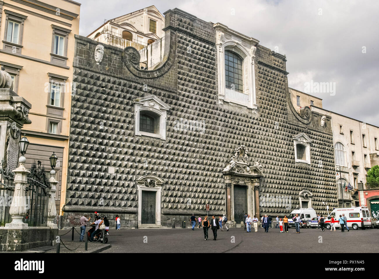 The Church of Gesu Nuovoin Naples, southern Italy. The Church of Gesu Nuovo was originally a palace built in 1470 for Roberto Sanseverino, Prince of Salerno. The unusual building is faced with with rustic ashlar diamond projections. Stock Photo