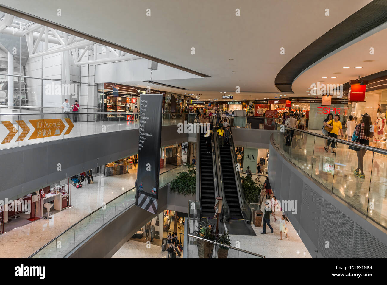 Tung Chung Wan, Hong Kong, China- June 11, 2014: people shopping at the CityGate Outlet shopping mall in Lantau island near the airport - Stock Image