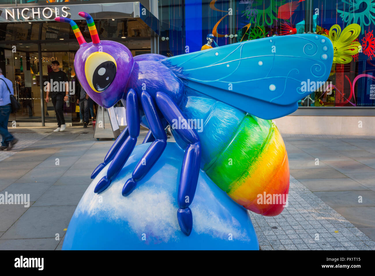 Bee a Rainbow!, by Rachel A Blackwell.  One of the Bee in the City sculptures, New Cathedral Street, Manchester, UK. - Stock Image