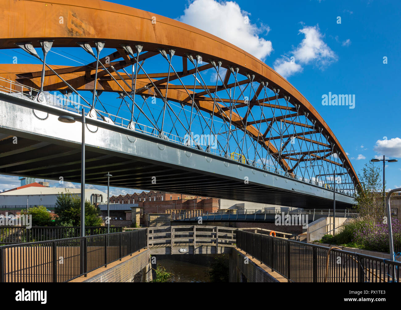 The Ordsall Chord rail bridge over the river Irwell at the junction with the Manchester, Bolton and Bury canal, Salford, Manchester, England, UK - Stock Image