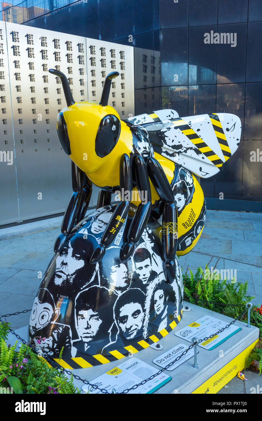 Bee Here Now, by Joseph Venning.  One of the Bee in the City sculptures, First Street, Manchester, UK. - Stock Image