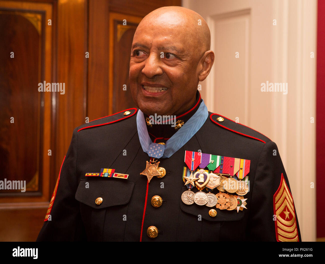Retired U.S. Marine Corps Sgt. Maj. John L. Canley, the 300th Marine Medal of Honor recipient, attends a reception after the Medal of Honor ceremony at the White House in Washington, D.C., Oct. 17, 2018. From Jan. 31, to Feb. 6 1968 in the Republic of Vietnam, Canley, the company gunnery sergeant assigned to Alpha Company, 1st Battalion, 1st Marines, took command of the company, led multiple attacks against enemy-fortified positions, rushed across fire-swept terrain despite his own wounds and carried wounded Marines into Hue City, including his commanding officer, to relieve friendly forces wh Stock Photo