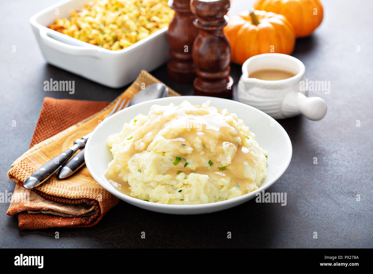 Mashed potatoes with gravy, traditional side dish for Thanksgiving - Stock Image
