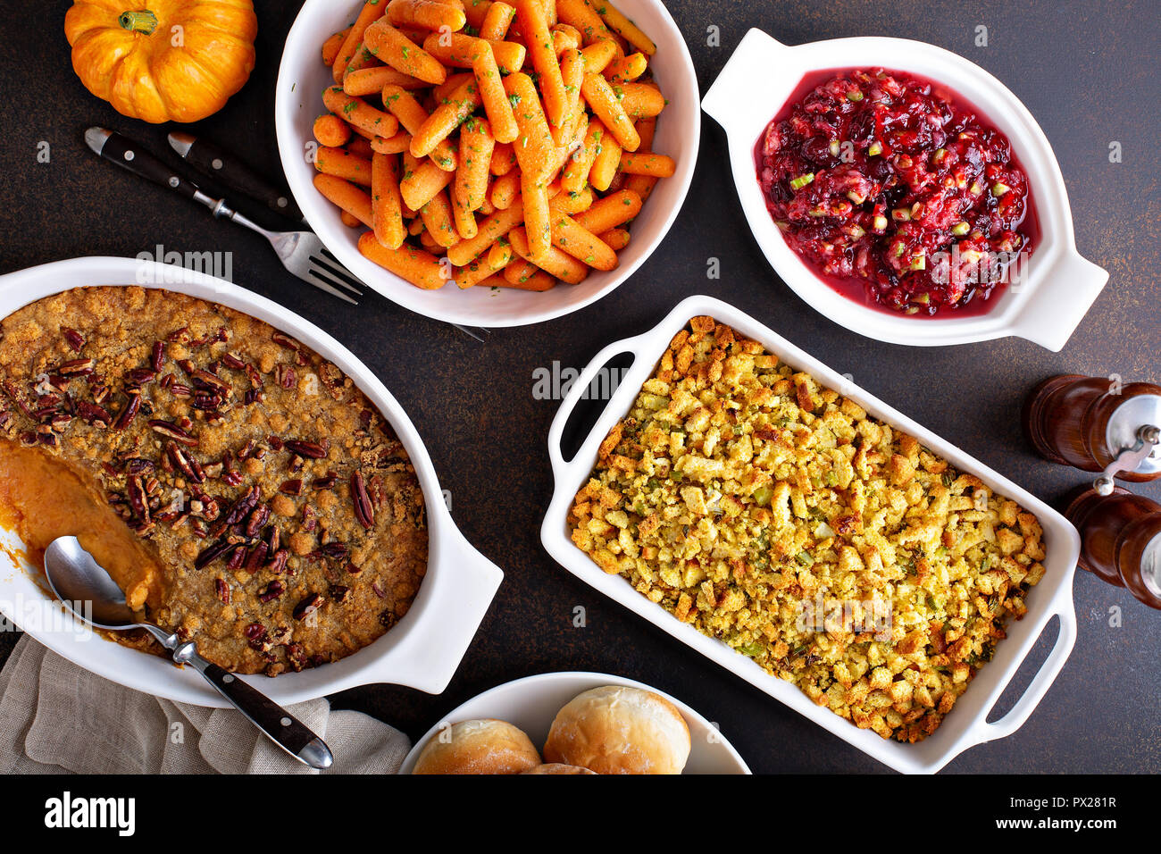 All Traditional Thanksgiving Side Dishes Roasted Carrots Sweet Potato Casserole Cranberry Sauce And Stuffing