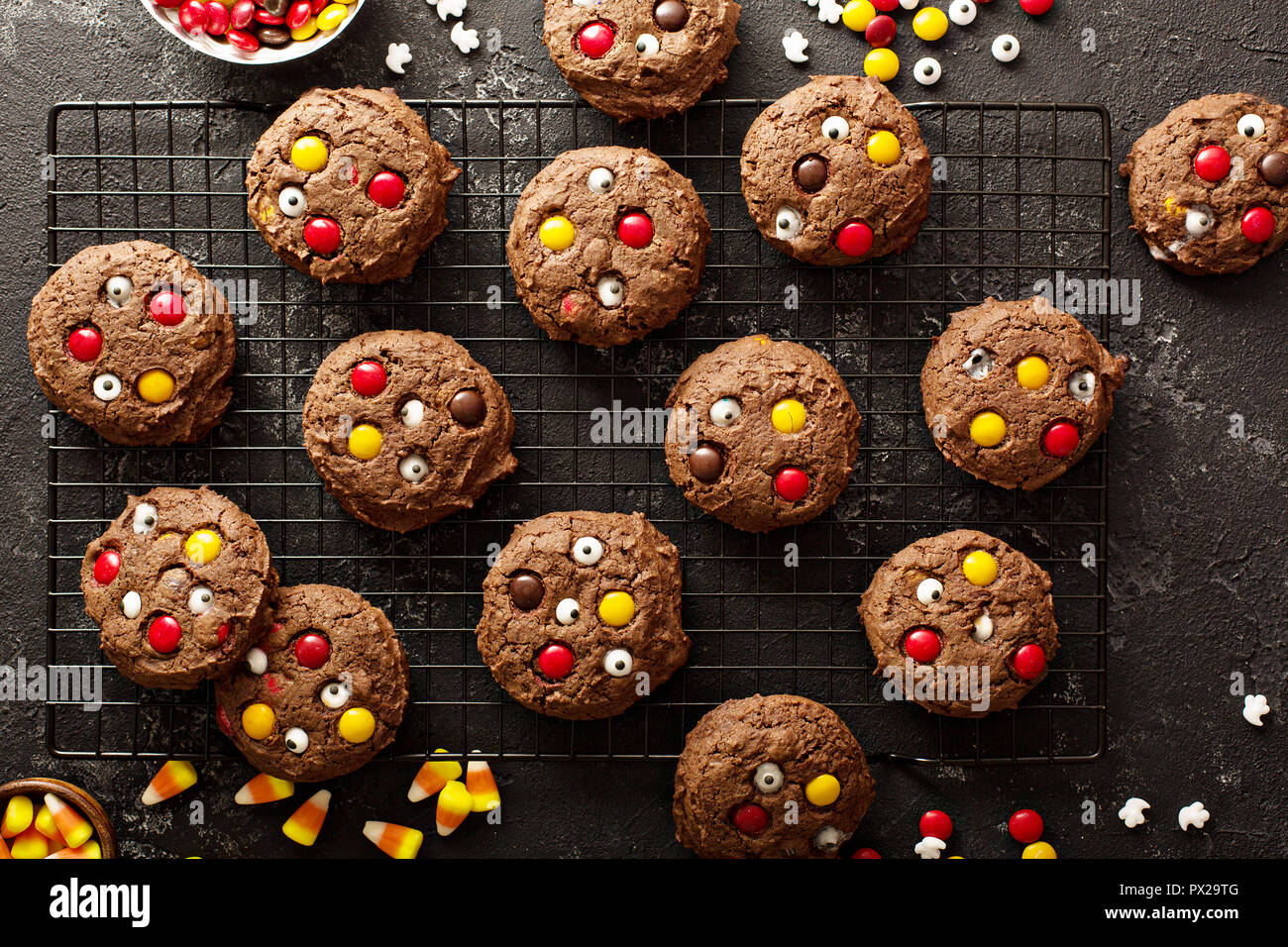 Chocolate cookies with candy and sugar eyeballs for Halloween - Stock Image